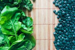 Greens and spirulina. Various greens and spirulina in tablets are very useful for the body as suppliers of fiber, chlorophyll, various vitamins and minerals stock photography