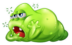 A greenslime monster in boredom Stock Image