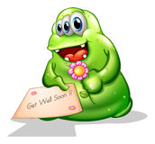 A greenslime monster holding a signage Royalty Free Stock Photography