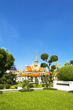Greensward and church  Wat Arun Royalty Free Stock Photos