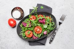 Greent salad mix. Green salad mix plate with rucola, frisee, radicchio and lamb`s lettuce. Top view stock photography