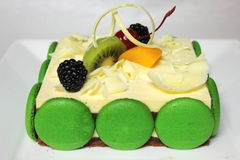Greentea cake with macaroon and fresh fruit Stock Photo