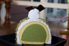 Greentea icecream cake on wood table Royalty Free Stock Photos