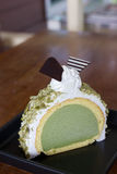 Greentea icecream cake on wood table Royalty Free Stock Photo