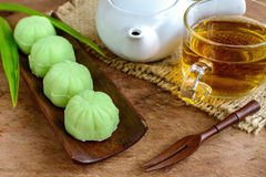 Greentea mochi flavored with bean filling and cup of tea Royalty Free Stock Images