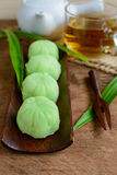 Greentea mochi flavored with bean filling and cup of tea Stock Image