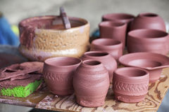 Greenware Pottery. A sampling of just created small pottery dishes fresh off the wheel Stock Photo