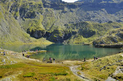 Turquoise water lake in the high mountains Stock Images