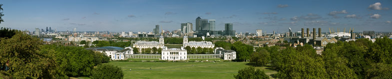 Greenwich and Canary Wharf. London's National Maritime Museum and skyscraper of Canary Wharf stock photos