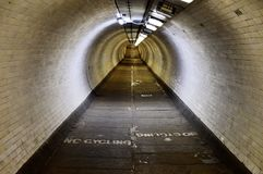 Greenwich Foot Tunnel, under the Thames River. Inside the underground Greenwich foot tunnel, dug under the Thames River, connecting Greenwich to the Isle of Dogs stock image