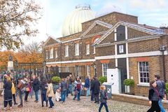 Greenwich, London, UK - October 30 2016: Unidentified visitors a. T the Prime Meridian Line at the Royal Observatory in Greenwich stock photos