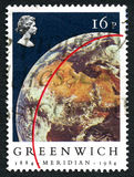 Greenwich Meridian Postage Stamp. GREAT BRITAIN - CIRCA 1984: A used postage stamp from the UK, commemorating the 100th Anniversary since the Greenwich Meridian Stock Photo