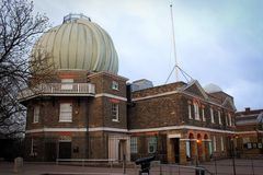 Greenwich Observatory building view, London. Old Royal Observatory building in Greenwich Park view, London, Great Britain stock photo