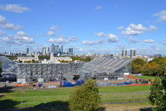 Greenwich Park View, Olympic Equestrian Building, O2,  Canary Wharf London. An unusual view looking across Greenwich Park to the tall modern buildings at Canary Stock Photos