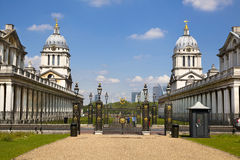 Greenwich Royal navy office, classic colonnade and Canary Wharf business district on the background Royalty Free Stock Images