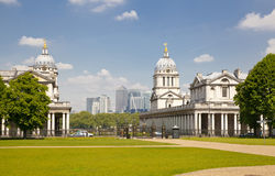 Greenwich Royal navy office, classic colonnade and Canary Wharf business district on the background Royalty Free Stock Photography