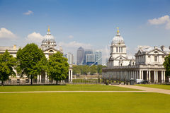 Greenwich Royal navy office, classic colonnade and Canary Wharf business district on the background Royalty Free Stock Photo