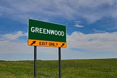 US Highway Exit Sign for Greenwood. Greenwood `EXIT ONLY` US Highway / Interstate / Motorway Sign royalty free stock photo