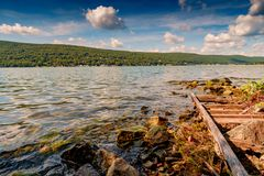 Greenwood Lake NY Summer. Scenic view of Greenwood lake on summer day with cloudscape stock images