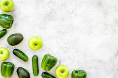 Greeny cocktail ingredients. Fitness smoothie. Cucumber, pepper, apple, avocado on stone background top view space for. Text Stock Images