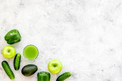 Greeny cocktail ingredients. Fitness smoothie. Cucumber, pepper, apple, avocado on stone background top view space for. Text Stock Photo