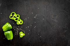 Greeny cocktail ingredients. Fitness smoothie. Pepper on black background top view space for text.  royalty free stock images