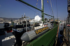 Greepeace boat. The Greenpeace Ship Rainbow Warrior moored in the port of Genoa stock photos