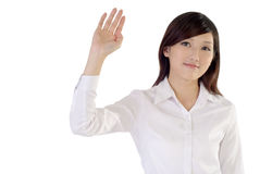 Greet. Business woman of Asian raise hand to greet on white background royalty free stock photos