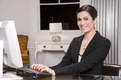 Female Desk Greeter In the Office Workplace Stock Photo