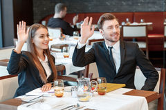 Greeting acquaintances during the business lunch Stock Photo