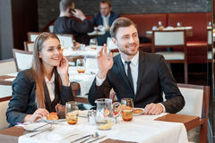 Greeting acquaintances during the business lunch Royalty Free Stock Images