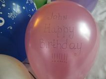Greeting balloons with the name john