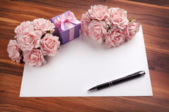 Greeting blank card with roses and gift Royalty Free Stock Photo