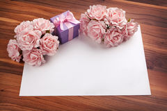 Greeting blank card with roses and gift Stock Photography