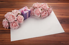 Greeting blank card with roses and gift Stock Photos
