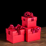Greeting boxes with bow on wooden background is , closeu Royalty Free Stock Images