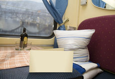 Greeting card. On the table of first-class compartment Royalty Free Stock Photography