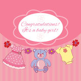 Greeting card on baby girl  shower. Background with illustration of baby girl toys Royalty Free Stock Images