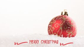 Greeting card with baubles in the snow Royalty Free Stock Image