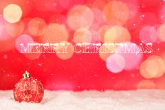 Greeting card with baubles in the snow Stock Photo