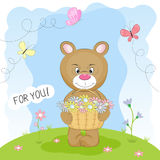 Greeting card bear in the meadow carrying a basket of flowers. Stock Photography
