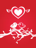 Greeting card with birds. Funny greeting card with two stilized birds on a tree branch. St. Valentines and weddings romantic illustration. Red and white Stock Photos