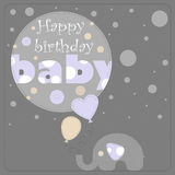 Greeting card for birthday child. Depicts an elephant holding balloons and gray circles of varying size. On the largest circle the phrase happy birthday baby Royalty Free Stock Photos