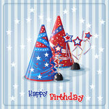 Greeting card with a birthday hats and confetti Stock Photos