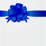 Greeting card with blue satin bow Stock Photos