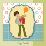 Greeting card with boy and big gift Stock Photo