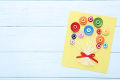 Greeting card with buttons. Handmade greeting card with buttons on wooden table stock image