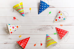 Greeting card for carnival party. Party hat and candles on woode Royalty Free Stock Photography