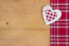 Greeting card with checkered red and white heart for Christmas o stock images