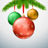 Greeting card with Christmas balls, fir tree branches and snowflakes Royalty Free Stock Images